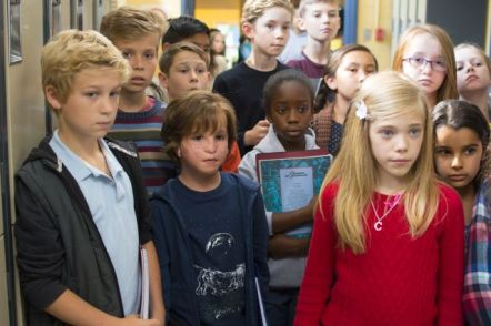 """Jacob Tremblay as """"Auggie"""" and Elle McKinnon as """"Charlotte"""" in WONDER."""